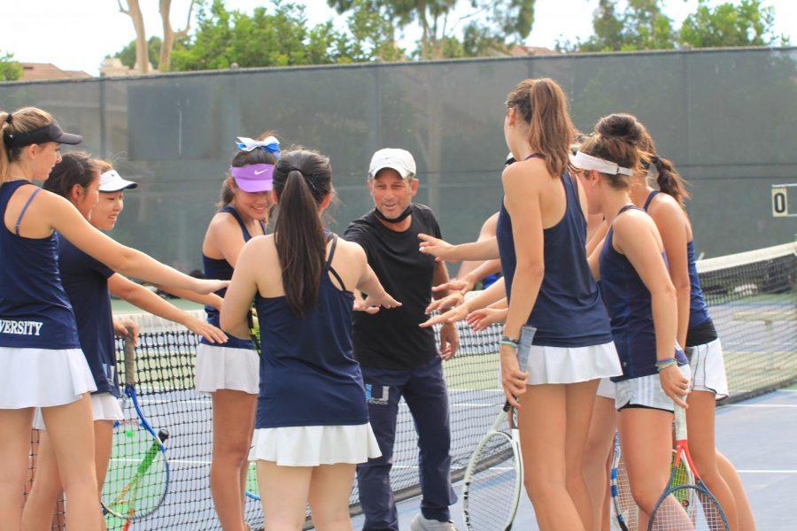 The team huddles around coach Kessler for words of encouragement.